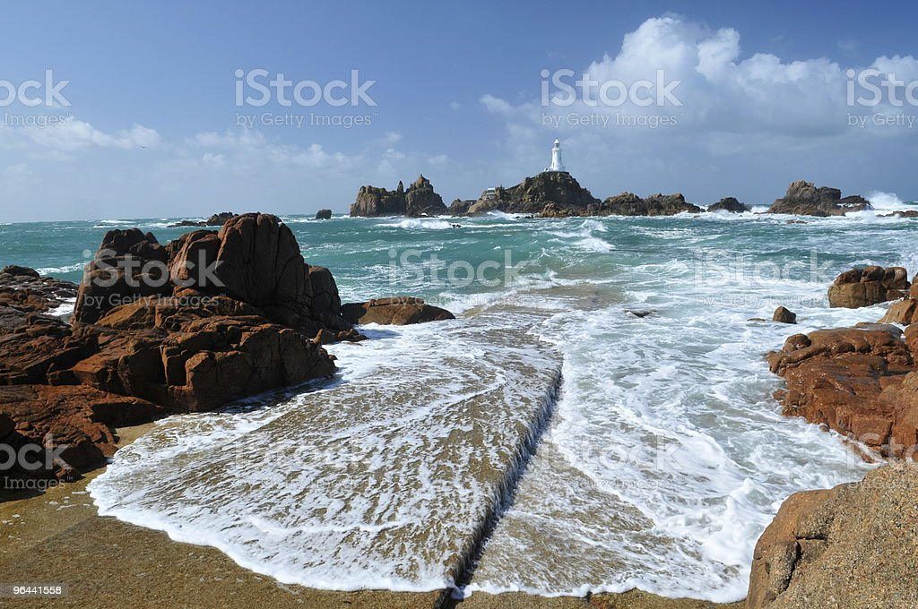 Corbiere Lighthouse, Jersey as seen from the rocky shore stock photo