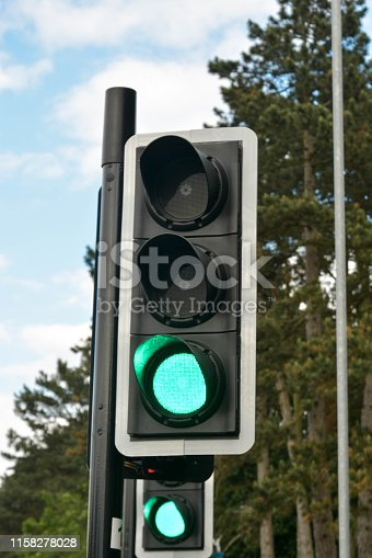 istock Corby, U.K., june 20, 2019 - Green color on the traffic light, pedestrian crossing. 1158278028