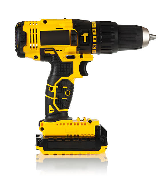 Cordless driver drill Cordless driver drill on a white background. cordless phone stock pictures, royalty-free photos & images