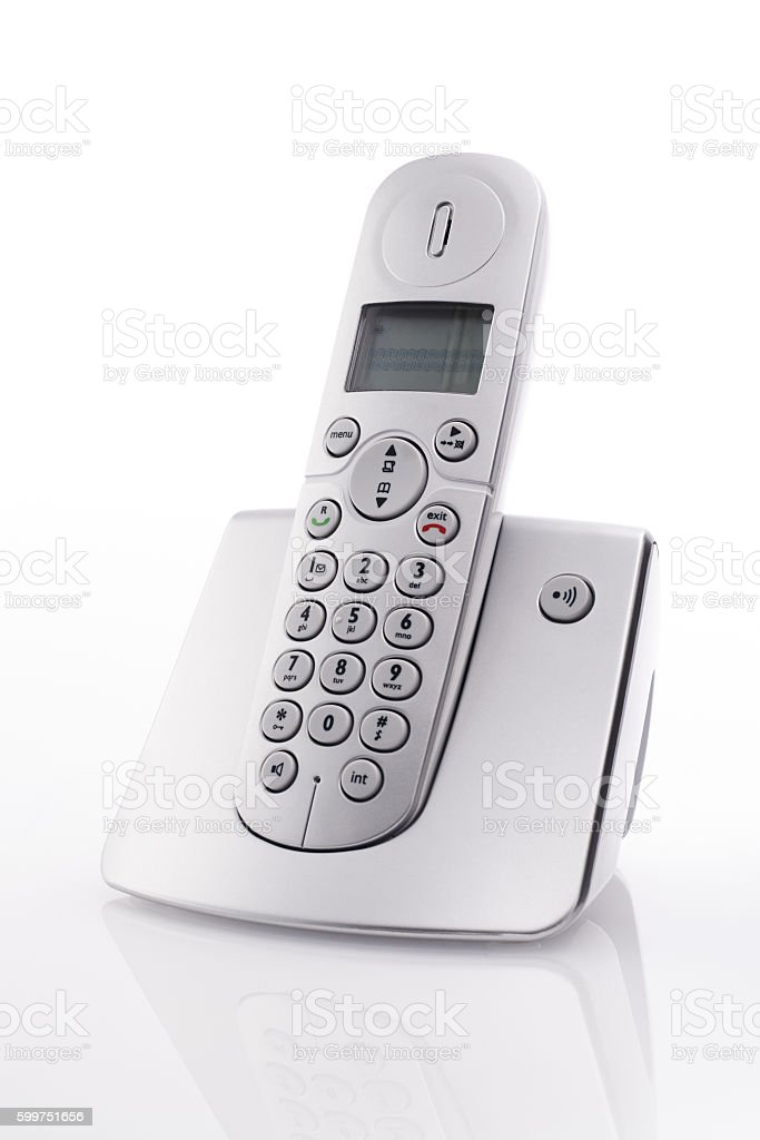 Cordless landline telephone on charger stock photo