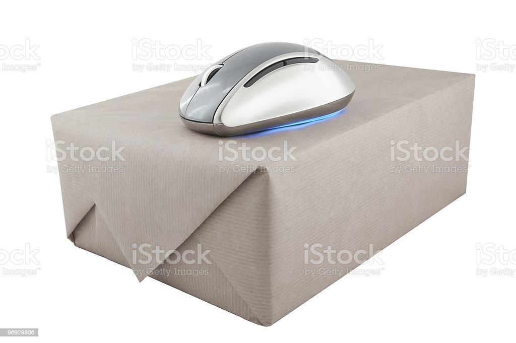 Cordless mouse at the top of package with brown wrapping royalty-free stock photo