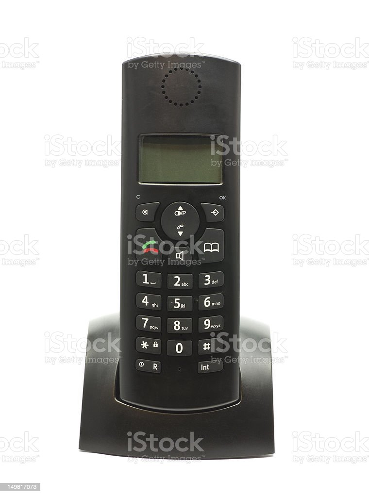 Cordless phone in cradle on white background. stock photo