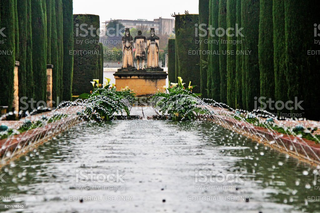 Cordoba, Andalusia, Spain - March 14, 2017 - Statue represents Christopher Columbus talking to King Ferdinand II of Aragon and Queen Isabella in the gardens of the Alcazar de Cordoba stock photo