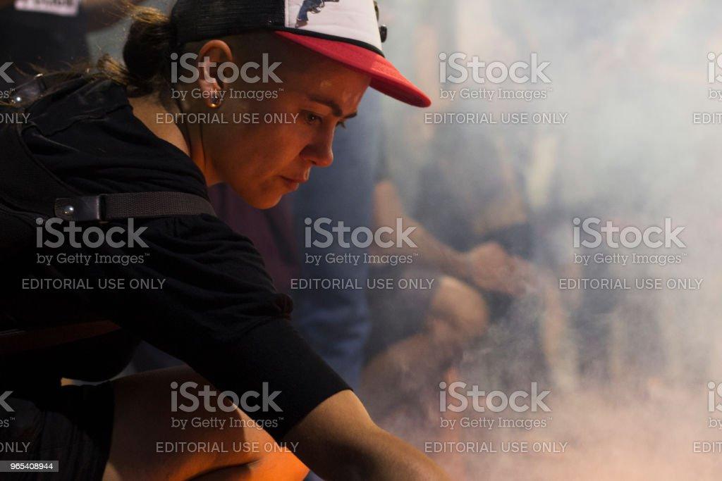 Cordoba, Argentina - November 17, 2017 - girl ignites fire in social protest royalty-free stock photo