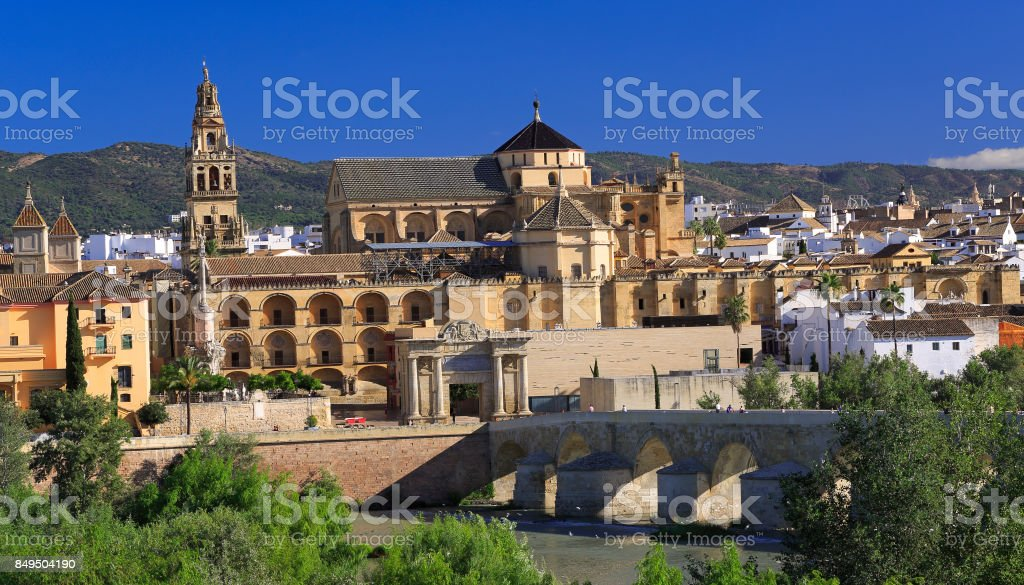 Cordoba skyline. The Roman Bridge and Mosque (Cathedral) on the Guadalquivir River stock photo