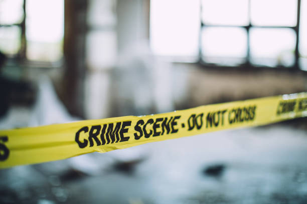 Cordon Tape On A Crime Scene Detectives and forensics on murder crime scene collecting evidence crime stock pictures, royalty-free photos & images