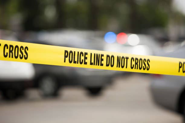 Cordon Tape Cordon tape seals off an active crime scene. crime stock pictures, royalty-free photos & images