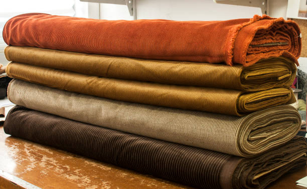 corduroy fabrics in sewing studio - corduroy stock pictures, royalty-free photos & images
