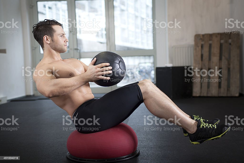 Core exercise with medicine and Togu ball stock photo