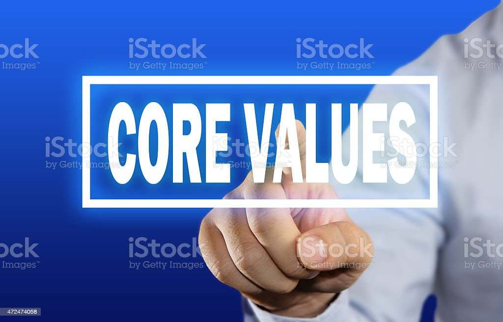 Core values in white on blue background stock photo
