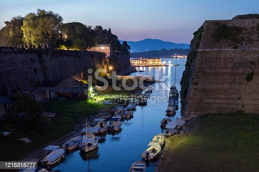 The northern side of Contrafossa opening to the Gulf of Kerkyra, Corfu island, Greece. View from the Old Fortress bridge. A lot of small boats. Dramatic sky.  stock photo