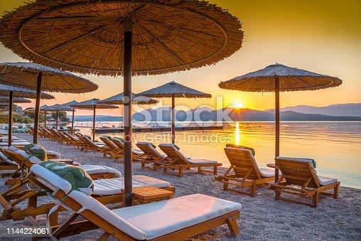 Vibrant sunrise over the beach in Corfu island, in Greece