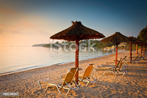 summer beach and row of umbrellas - Corfu - Greece