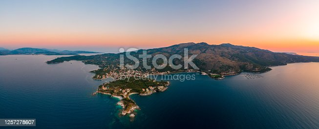 Corfu, Kerkyra, aerial panoramic photo of the town and port of Cassiopeia / Kassiopia at summer dusk