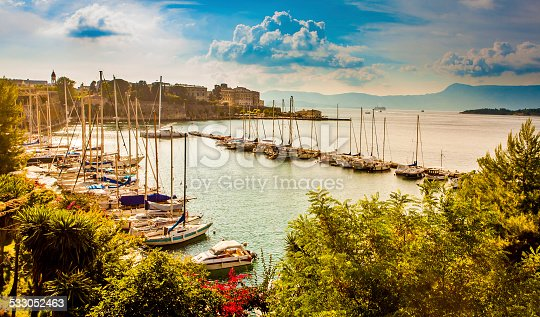 Marina with small moored yachts and Old Town. View from Old Fortress. Kerkira (Corfu town). Greek islands.