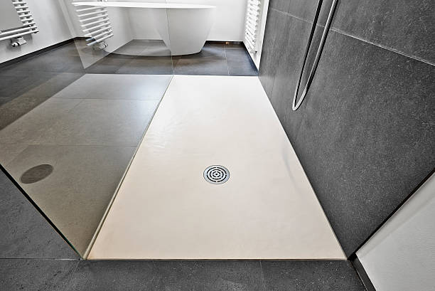 Corian floor and drain stock photo