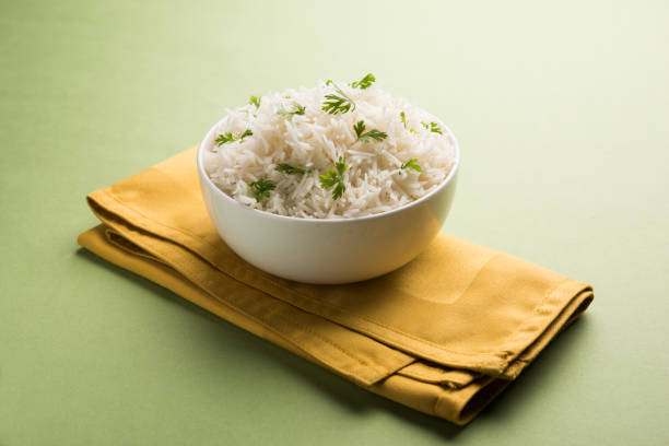Coriander or cilantro Basmati Rice, served in a ceramic or terracotta bowl. It's a popular Indian OR Chinese recipe. Selective focus Coriander or cilantro Basmati Rice, served in a ceramic or terracotta bowl. It's a popular Indian OR Chinese recipe. Selective focus basmati rice stock pictures, royalty-free photos & images