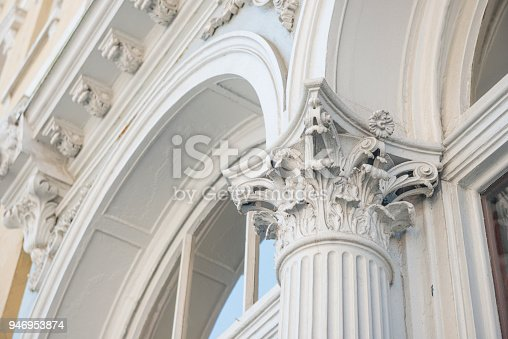 This is a color photograph of historic architecture with an elaborate Corinthian style capital on a column in the exterior of a building in historic Charleston, South Carolina, a travel destination in the Southern USA.