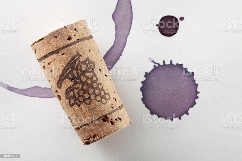 Cork and red wine stain stock photo