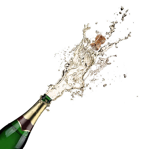 A cork being popped on a champagne bottle Close-up of champagne explosion. Celebration theme. 2013 stock pictures, royalty-free photos & images