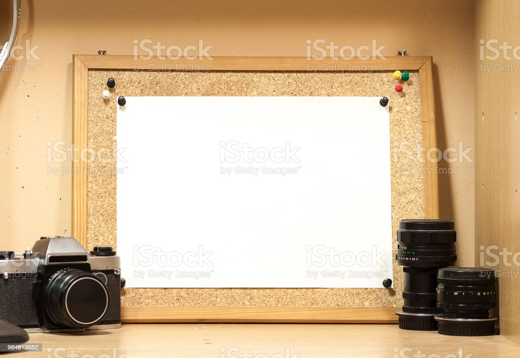 A cork board with a white sheet of paper. Background for mockup. royalty-free stock photo