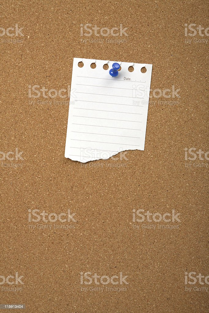 Cork board with blank sheet royalty-free stock photo