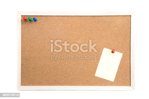istock Cork board with post it and push pins and wooden frame on white background with clipping path 863528516