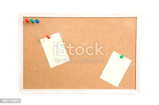 istock Cork board with post it and push pins and wooden frame on white background with clipping path 864148932