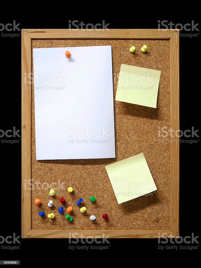 Cork board with poster notes and tacks stock photo