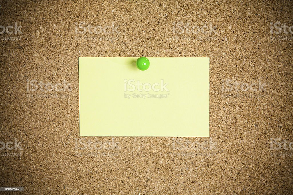 Cork board with yellow notes royalty-free stock photo