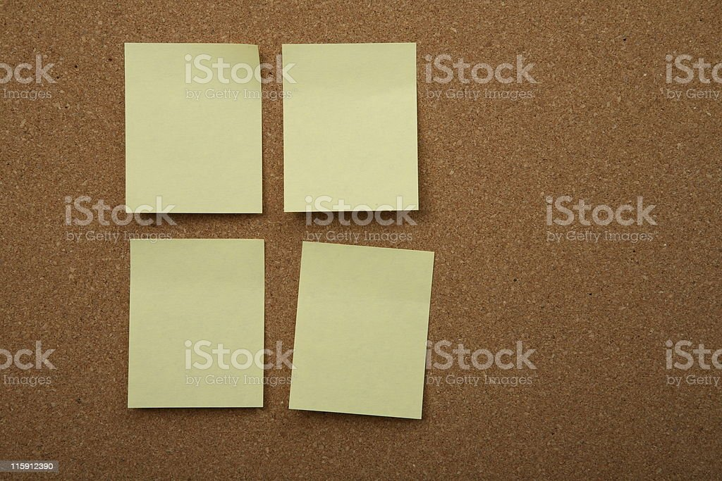 Cork board with yellow sticky notes stock photo