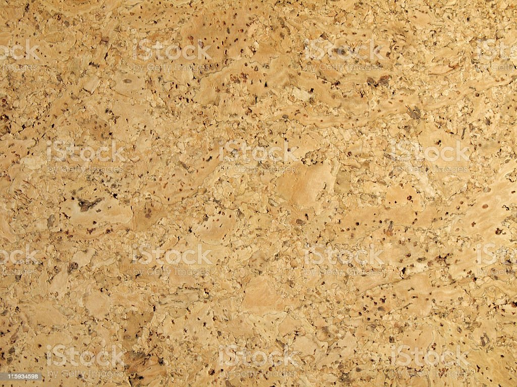 Cork close up view in tan color with black speckles stock photo