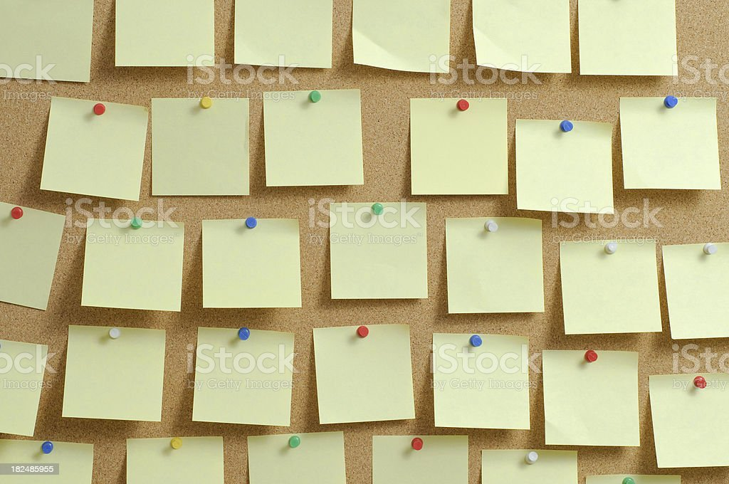 Cork pinboard with postits stock photo