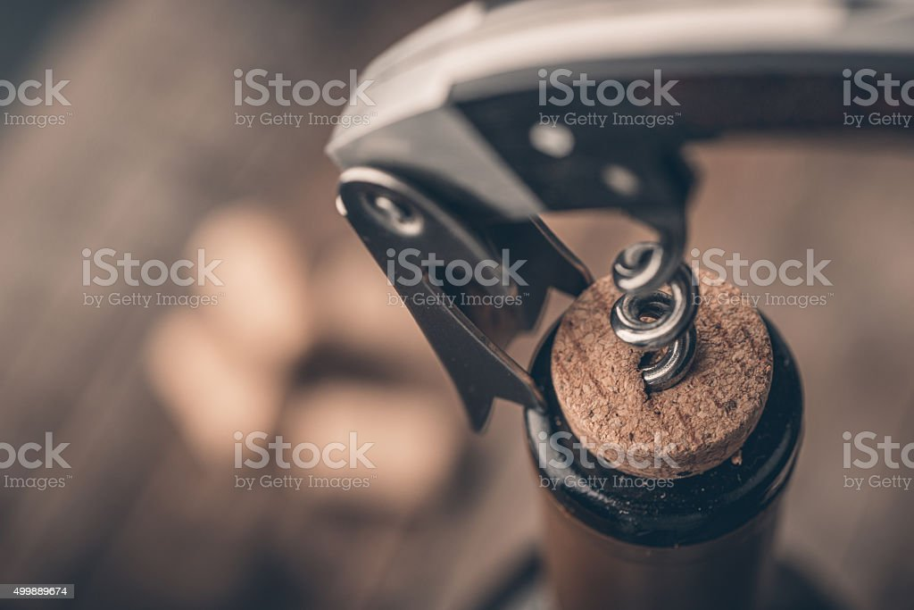 Cork screw and wine bottle stock photo