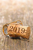 cork stopper of champagne with date of new year 2019