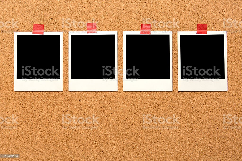 Corkboard and picture frames.