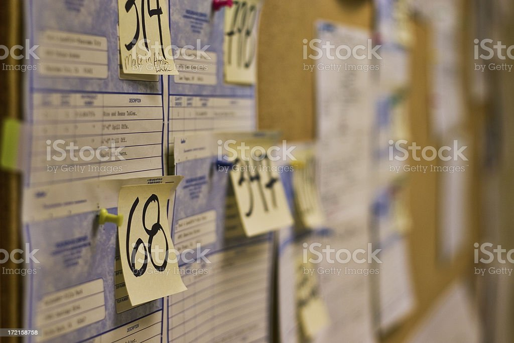 Corkboard with invoices royalty-free stock photo