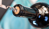 Corkscrew detail in a bottle of wine, conceptual image