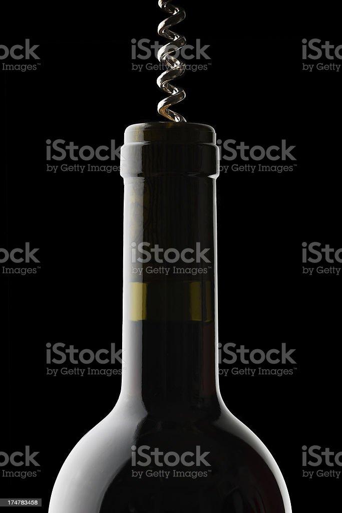 Corkscrew on wine bottle royalty-free stock photo