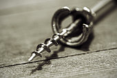 Corkscrew on old wood surface.