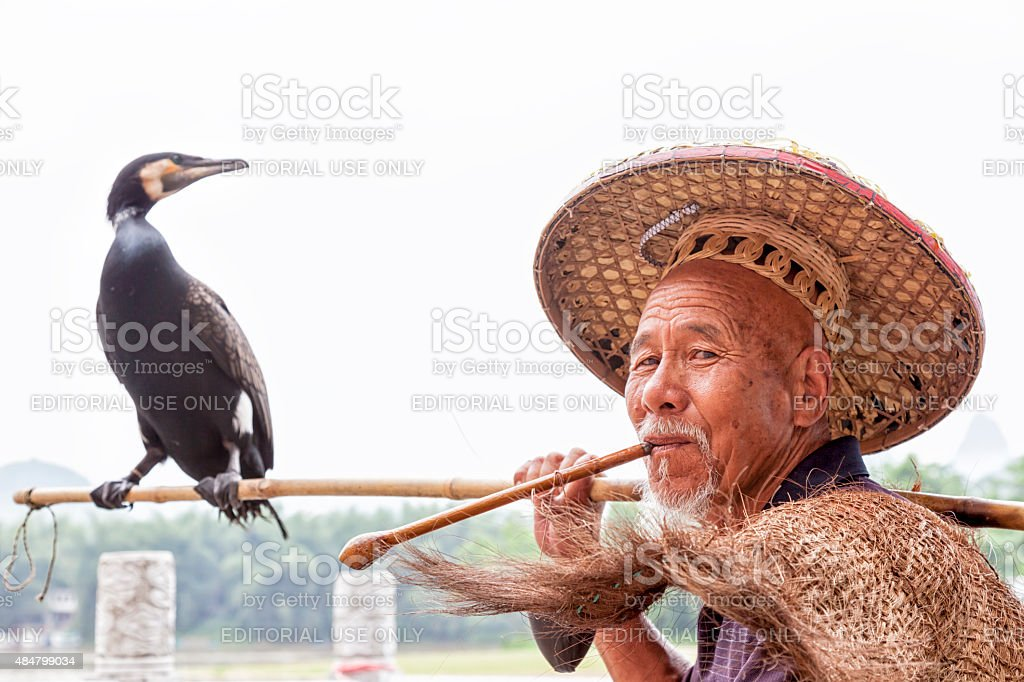 Cormorant Fisherman in Traditional Coolie Hat, Li River, Guilin, China stock photo