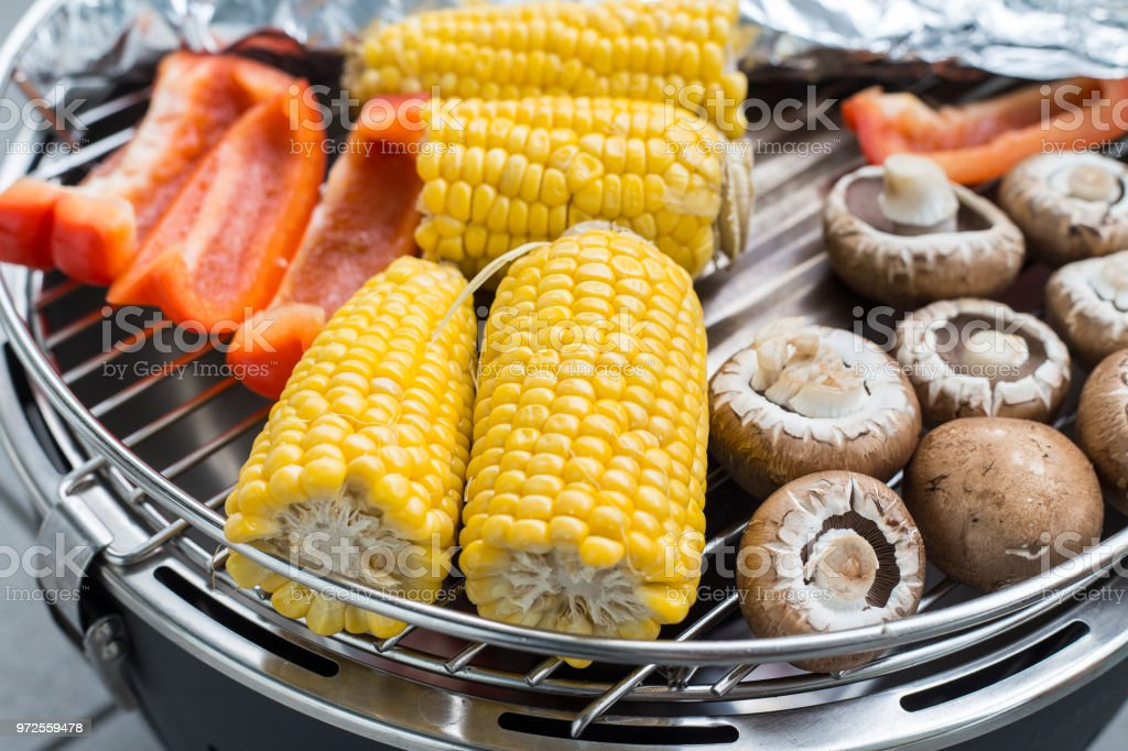 Corn and mushroom on the barbeque stock photo
