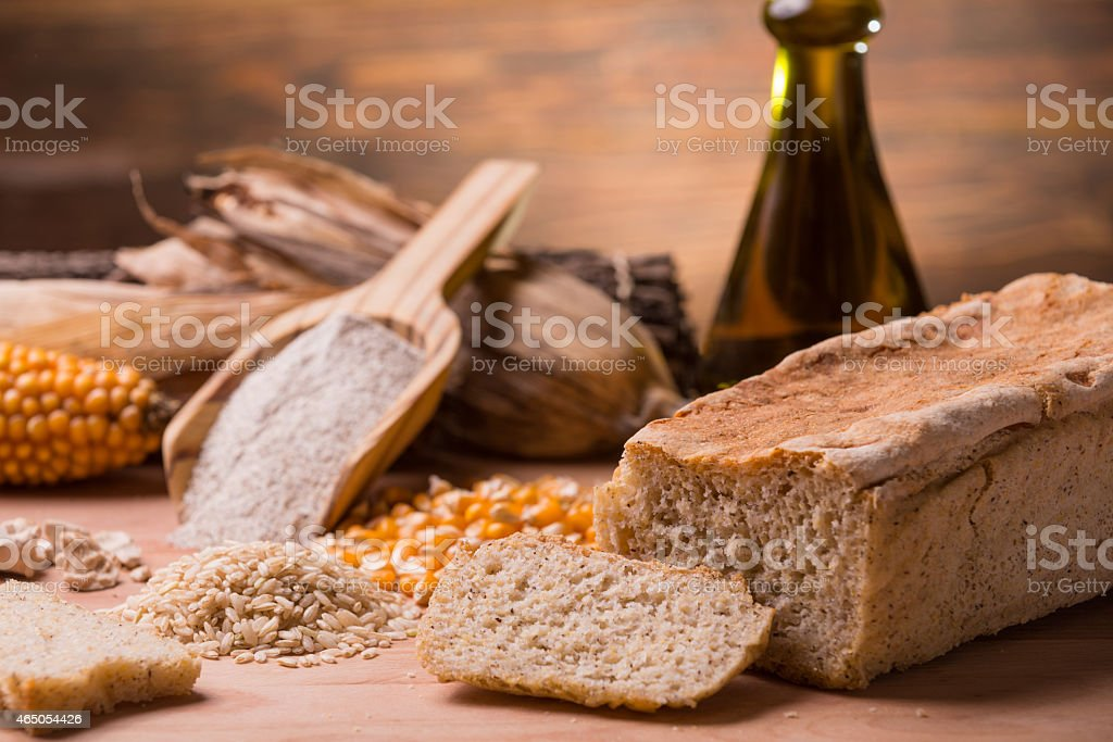 Corn and wheat with gluten free loaf of bread stock photo