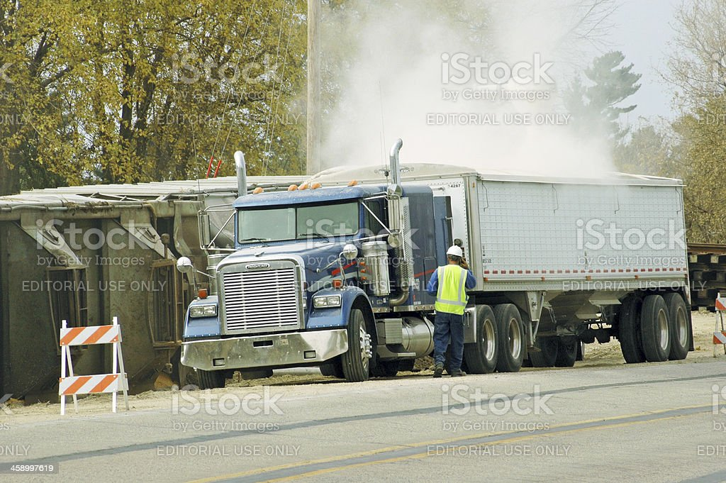 Corn being salvaged from derailed train in Iowa royalty-free stock photo