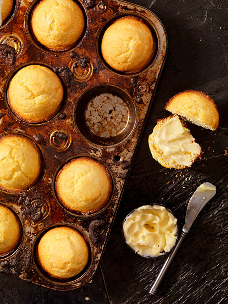 Corn Bread Muffins in Baking Tin Corn Bread Muffins in Baking Tin  -Photographed on Hasselblad H3D2-39mb Camera muffin tin stock pictures, royalty-free photos & images