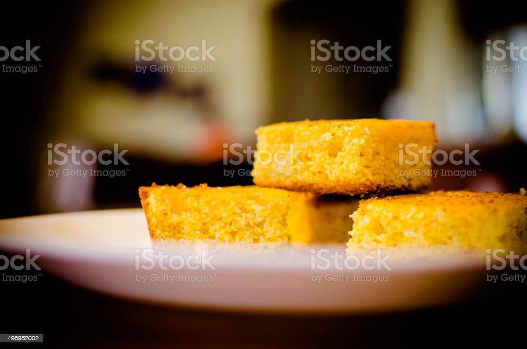 Corn bread on plate in kitchen stock photo