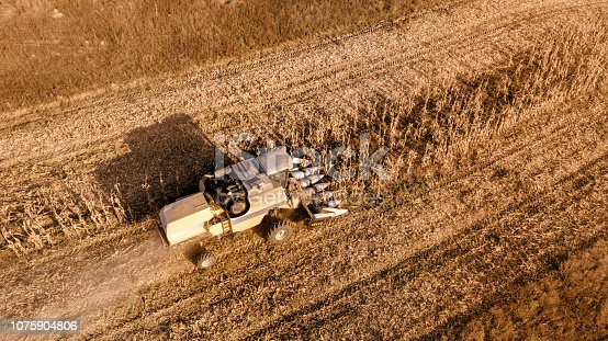 1072634078 istock photo Corn Cereal harvesting details. Aerial view of autumn harvest 1075904806