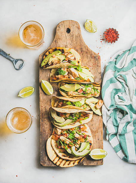 Corn chicken and avocado tortillas on wooden board, top view – Foto