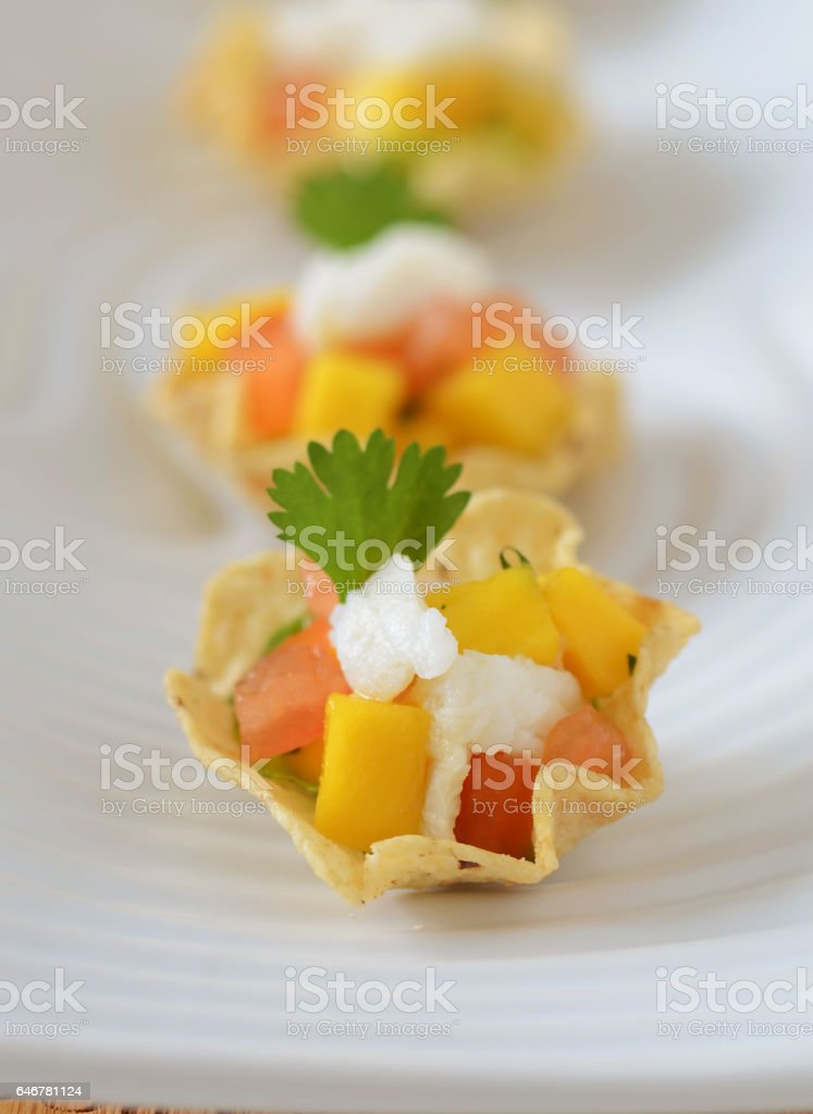 Corn Chip with Crab Meat and Mango Salsa stock photo