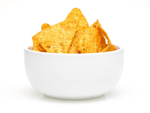 corn chips in bowl isolated on white background - chipsy zdjęcia i obrazy z banku zdjęć